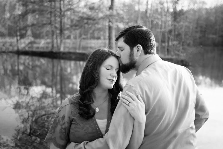 This is a maternity picture of a pregnant mom and new dad in Huntsville, AL demonstrating tips for amazing outfits for your maternity photoshoot, captured by Ellen Adams Photography.