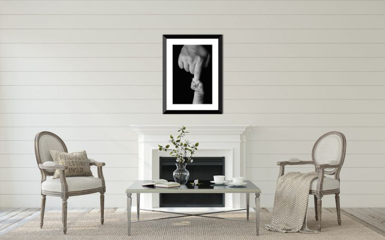 Huntsville newborn photography displayed above a fireplace