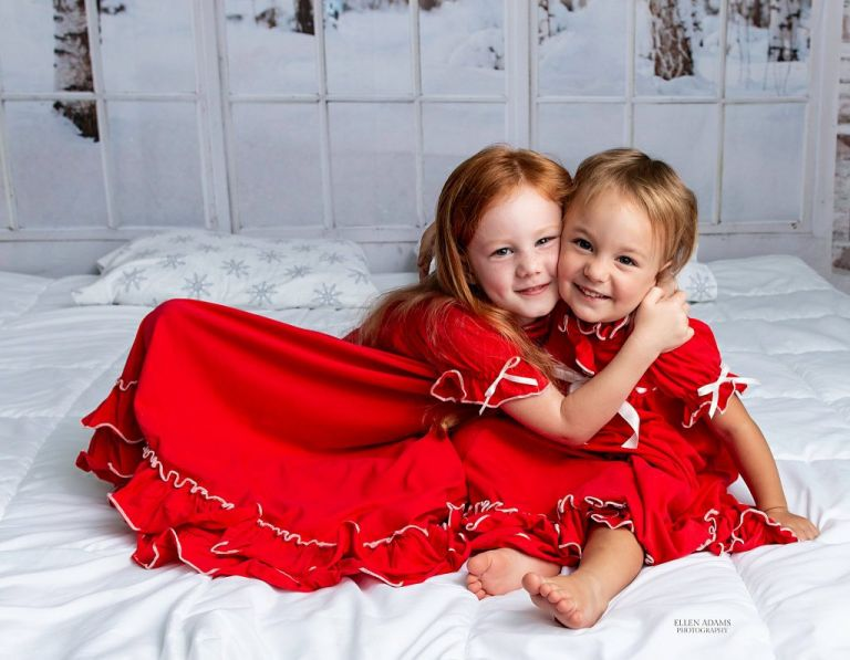 Christmas card picture in Huntsville of sisters hugging, captured by Ellen Adams Photography.