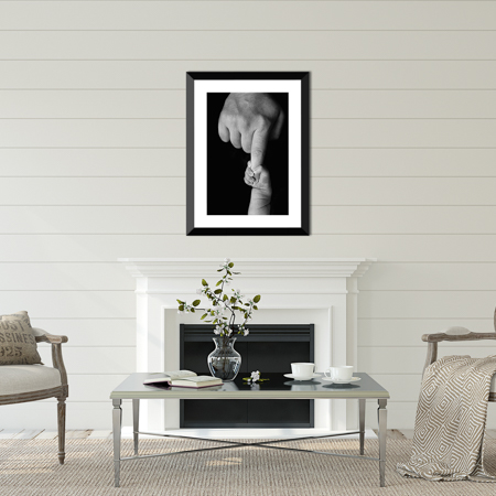 Newborn portrait by Ellen Adams Photography in Huntsville, AL displayed over a mantle