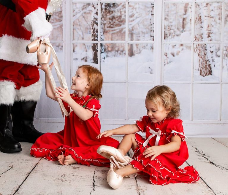 Santa picture in Huntsville, AL of girls with ballet shoes, captured by Ellen Adams Photography.