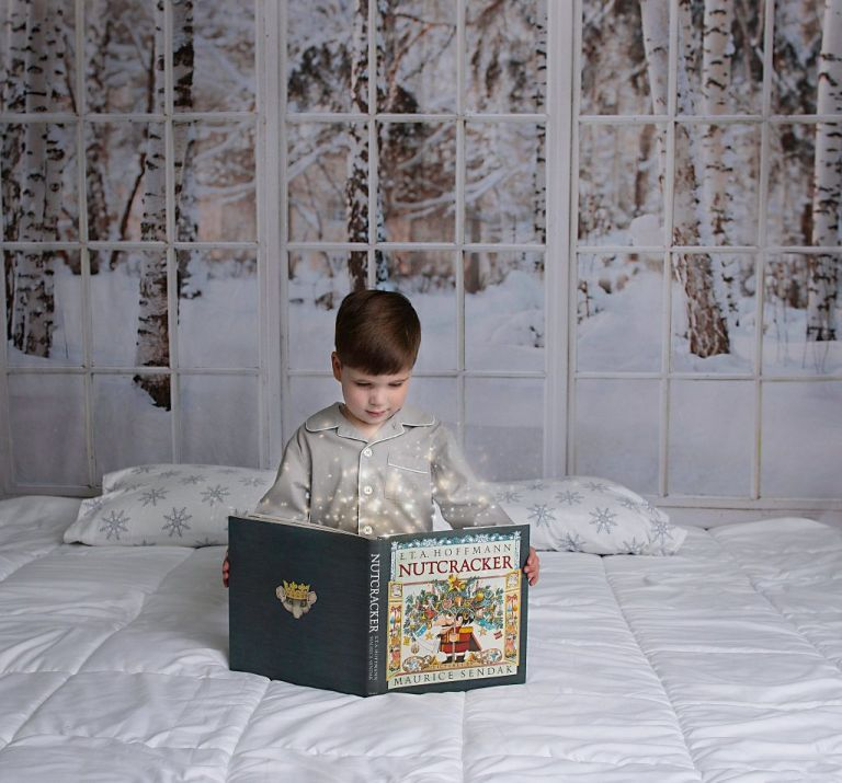 Huntsville Christmas Picture of boy holding magical Nutcracker book, by Ellen Adams Photography,