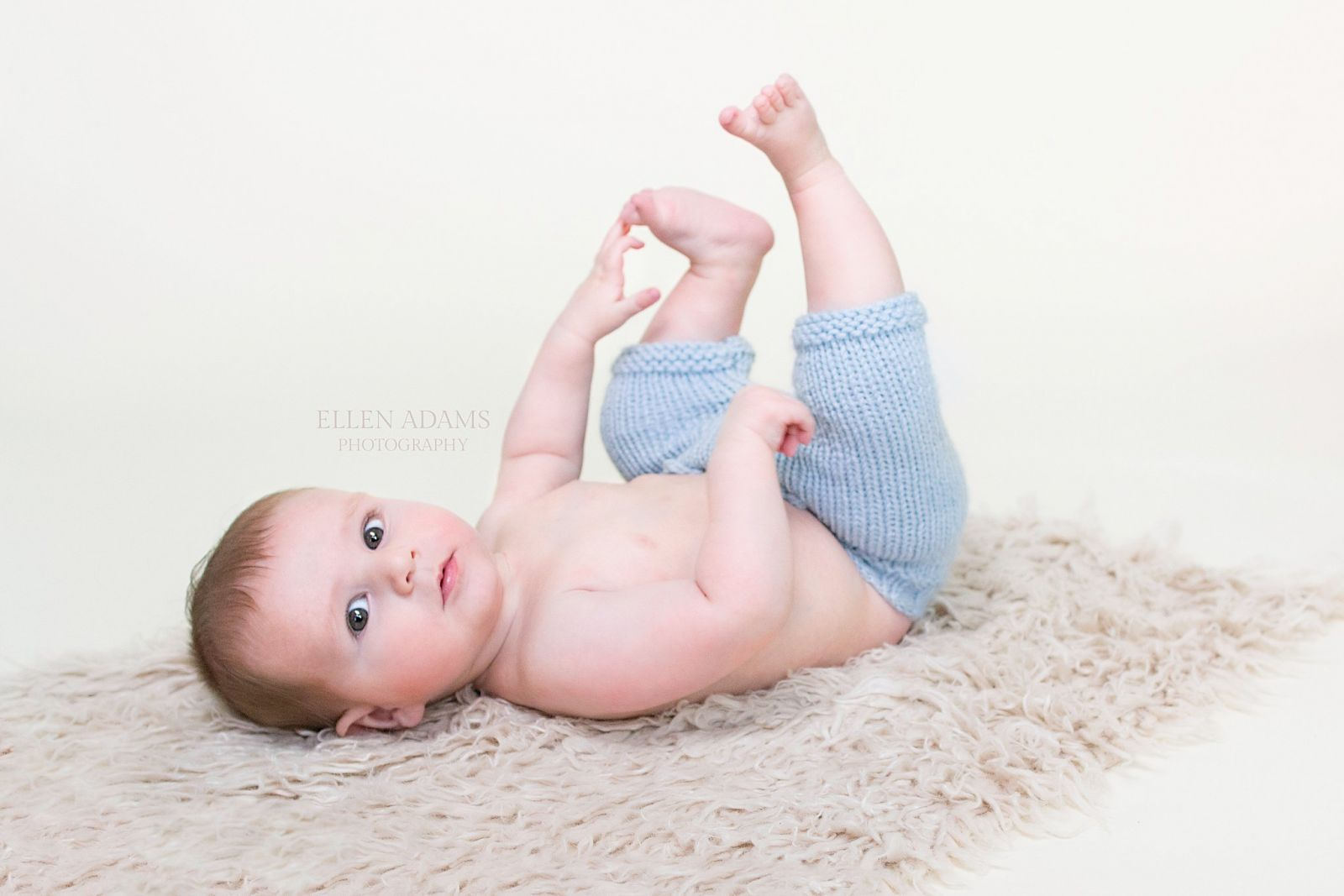 Picture of five month old baby during first milestone session of baby plan by Ellen Adams Photography