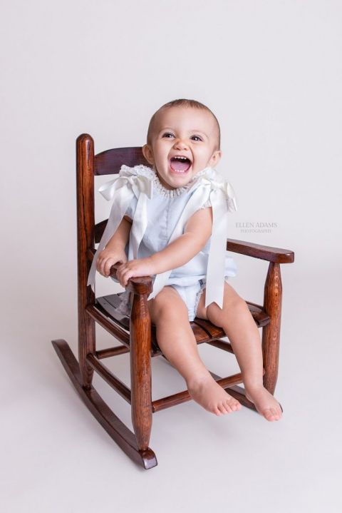 Hartselle baby photographer Ellen Adams Photography took this picture of a one year old baby in a rocking chair.