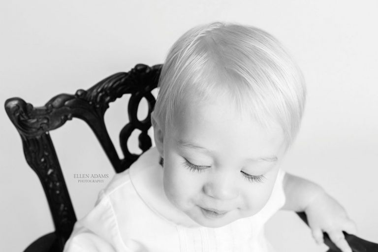 1 year portraits by Ellen Adams Photography in Huntsville AL picture of a baby's eyelashes in black and white.