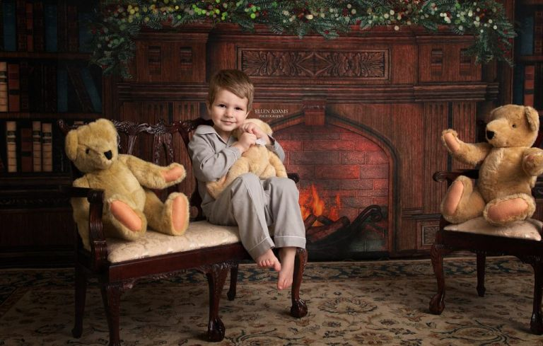 Christmas photoshoot of Huntsville Christmas Pictures by Ellen Adams Photography with a little boy hugging a teddy bear.
