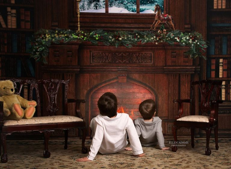 Christmas Pictures in Huntsville AL by Ellen Adams Photography of boys waiting for Santa by the fireplace.