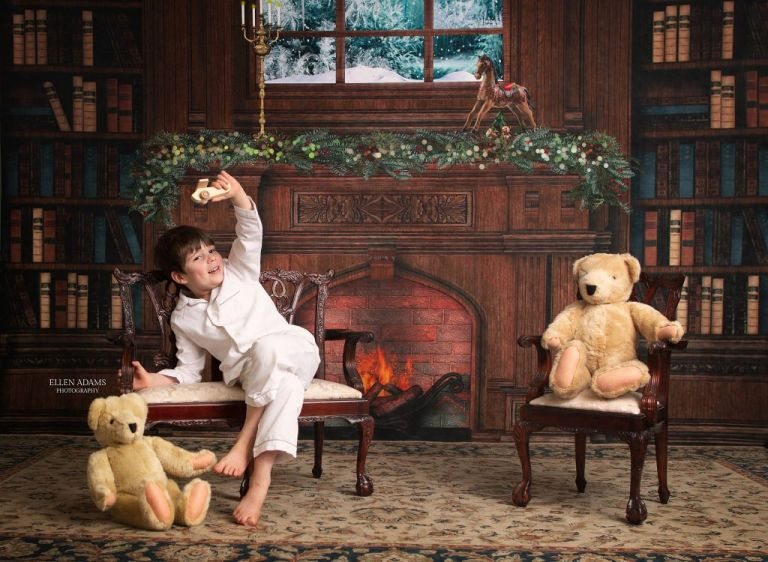 Christmas picture in Huntsville AL by Ellen Adams Photography of a boy playing with a toy airplane.