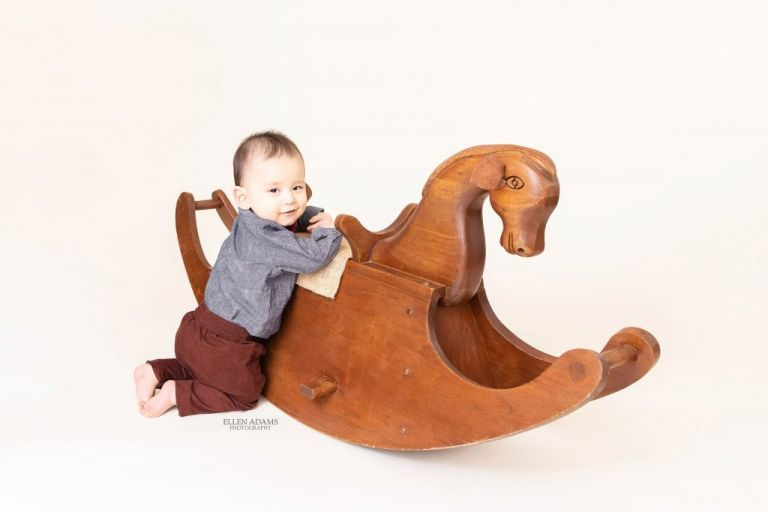 Baby Photoshoot image by Ellen Adams Photography of baby meeting his namesake's rocking horse.