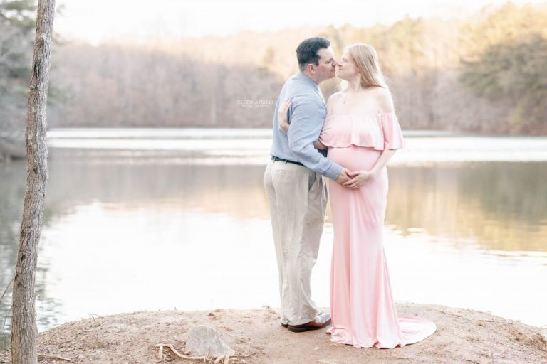 Ellen Adams Photography maternity photography in Huntsville AL picture of couple at a lake during sunset.